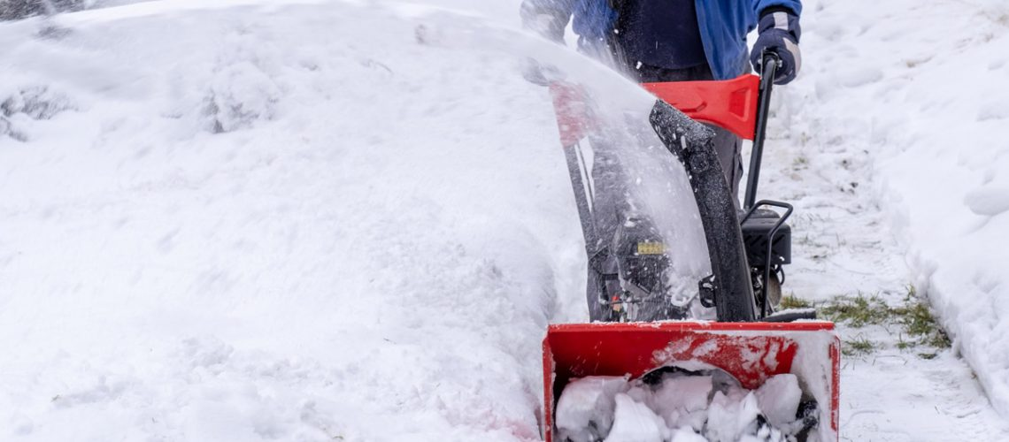 worker-easy-clears-street-yard-from-snow-by-snowblower-winter-post